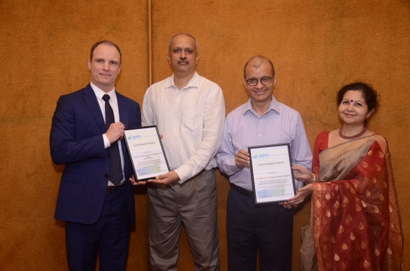 image of staffs holding certificates
